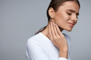 woman experiences tmj pain